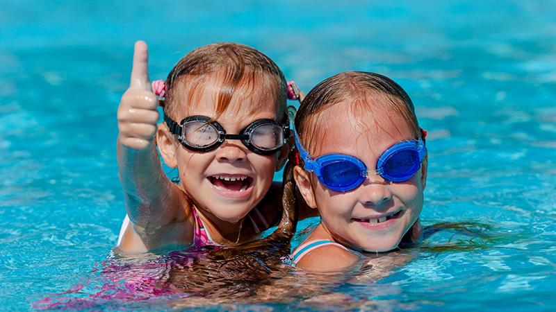 Kids swimming in pool