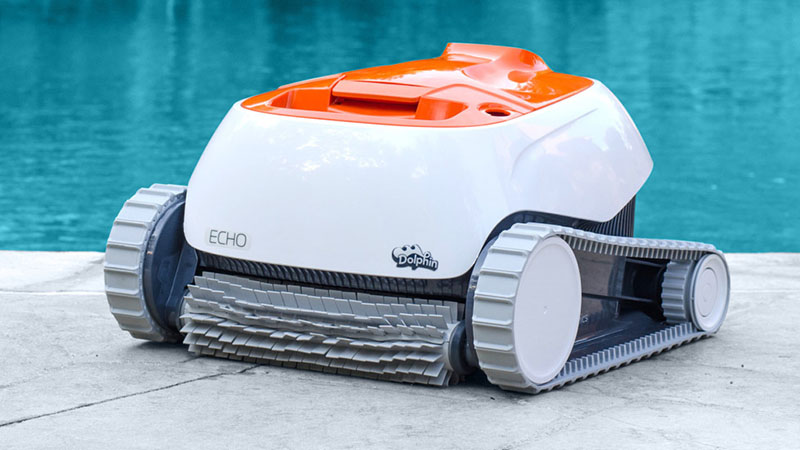 dolphin echo robotic pool cleaner sitting next to pool