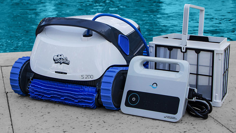 dolphin s200 robotic pool cleaner sitting by pool with power supply and filter element