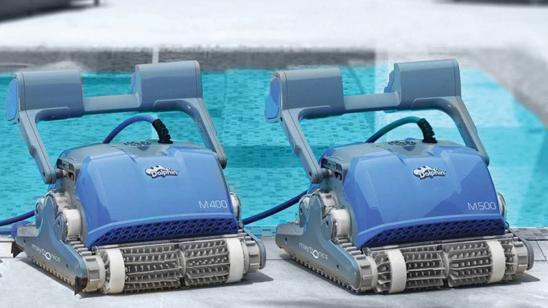 Maytronics Dolphin Robotic Pool Cleaners sitting poolside ready to use.