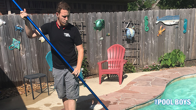 James providing weekly pool cleaning services to a customers pool.