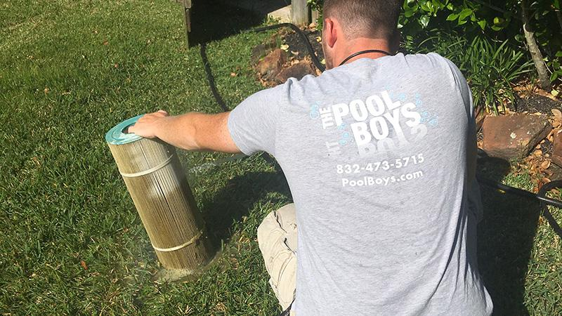The Pool Boys technician cleaning a Pool Filter Cartridge